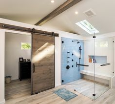 Barn door in a bathroom .... I think it looks great