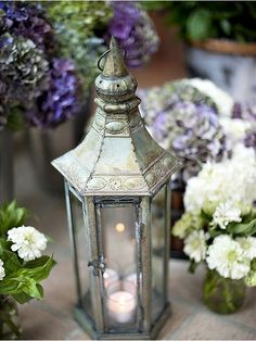Whimsical and romantic lanterns, candles, and flowers. Old Lanterns, Lanterns Decor, Lantern Lamp, Oil Lamps, Fairy Lights, Tea Lights, Eye Candy, Centerpieces, Candle Holders