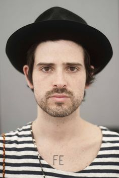 Devendra Banhart in Black Felt Hat and B Striped Shirt