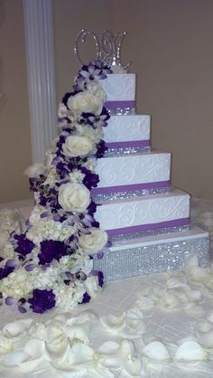 Beautiful cascading diamond and purple flower wedding cake