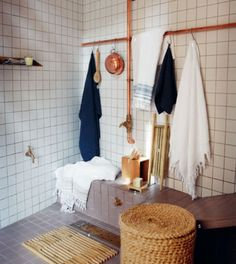 We love the copper pipes and taps in this bathroom.