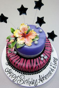 Sugar hibiscus and stars atop this  hand painted zebra on pink birthday cake.  Cakes By Graham, More Than Just the Icing on the Cake.  http://richmondcakes.com/