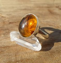 natural amber ring-amber silver ring-stone silver sterling silver ring-solid silver ring-energy stone ring-adjustable ring by ARTEAMANOetsy on Etsy Amber Ring, Amber Jewelry, Healing Stones, Crystal Healing, Amber Fossils, Adjustable Ring, Solitaire Ring, Sterling Silver Rings, Gemstone Rings