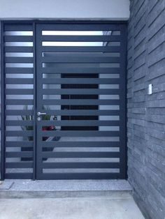 Custom Wrought Iron Gate that keeps strangers away and makes your neighbors envious! We love modern design!