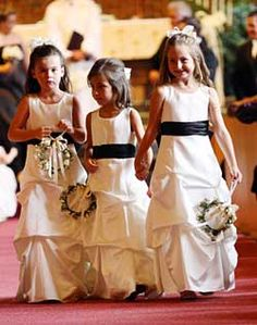 L<3VE the idea of multiple flower girls!..more specifically, three! Especially being that Bret's sweet nephews will be helping Bostyn walk down so there will be three ring bearers also :)