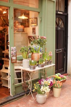 So inviting to have potted plants welcoming customers in. I really want to do this...