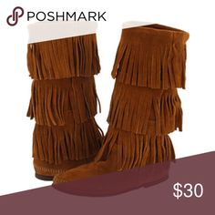 Fringe Moccasin Boots My favorite boots! The pair that I am selling is well worn  and loved, and I will be posting pictures of the signs of wear. They are still in wonderful condition though! You'll love the comfort and the versatility of these boots, just as I have. Minnetonka Shoes Moccasins