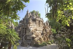 "Ferdinand Cheval (1836-1924) was a French postman who spent thirty-three years of his life building Le Palais idéal (the ""Ideal Palace"") in Hauterives. The Palace is regarded as an extraordinary example of naïve art architecture."