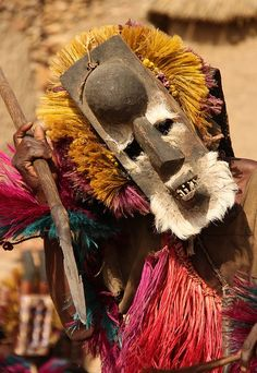Dancer with a monkey mask and spear symbolizing a hunter - Mali, Africa