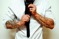 Something very attractive about a guy with tattoos wearing a suit; the golden standard. - cute-tattoo
