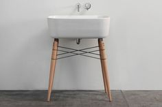 Ray Washstand Bathroom Sink Fantastic re-working of the Eiffel dowel leg Eames shell chair concept applied to a sink.