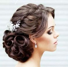 Stunning! We love the braid along the side running into a tight, large curled bun... so pretty.