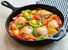 Chicken Afritada...chicken, potatoes, bell peppers, carrots and peas stewed in fresh tomatoes