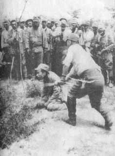 The moment a Chinese man is executed by a Japanese soldier during the Nanking Massacre; 1937