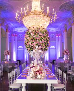 Incredible! Tall green, pink and purple centerpieces // Carla Gates Photography // http://blog.theknot.com/2013/12/10/this-glittery-cake-shines-at-historic-atlanta-venue/