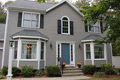 New paint exterior. Siding is Benjamin Moore Graystone front door is Benjamin Moore Philipsburg Blue Exterior Siding Options, Exterior Paint Schemes, Exterior Paint Colors, Exterior House Colors, Benjamin Moore Exterior Paint, Vintage Store, Front Door Colors, Layout, Vintage Design