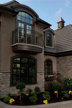 This Juliet balcony is so beautiful and I love the french doors.