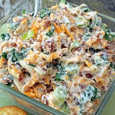 Neiman Marcus Dip - 6 green onions, 8oz. cheddar cheese, shredded, 1½cups mayonnaise, 1jar Hormel Real Bacon Bits, 1 pkg. slivered almonds, Chop the green onions.Shred the cheddar cheese. Mix the onions, cheese, mayo, bacon bits, and slivered almonds together.Chill for a couple hours.Serve with Ritz crackers or corn chips.
