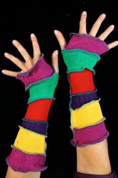 Here is a great pair of arm warmers made from bits of recycled knits. They have a candy-coated palette of vivid colors. Enjoy!  ************************************************************************************************************  About Katwise Sweaters:  I started making recycled patchwork hoodies 20 years ago, while I was a wee gypsy girl, following the Grateful Dead. Since then my style has evolved and grown into this etsy maddness. I have made thousands and thousands of sweaters…