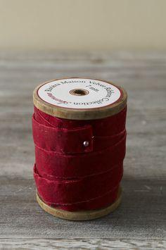 A spool of red velvet ribbon