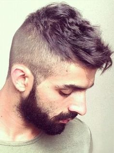 High short back & sides with cool choppy top and beard.