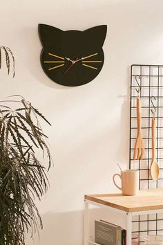 Gold and black cat wall clock. Cute and curious! Quirky home accessories which add fun and personality to home décor.