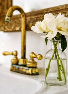 beautiful white flowers in a small vase next to the bathroom sink -- The Bathroom Gardening Guide: Potted Plants and Fresh Cut Flowers from Bathroom Bliss by Rotator Rod