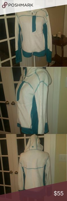Mountain Hardwear white fuzzy jacket size L Super warms and soft white and blue zip up hooded jacket.  Size large. Excellent condition! Perfect for this winter.  Worn only a handful of times. Mountain Hard Wear Jackets & Coats