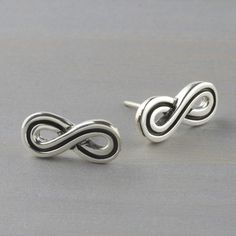 9ee970d83 Blending polished sterling silver with oxidized details, these infinity stud  earrings are a significant gift