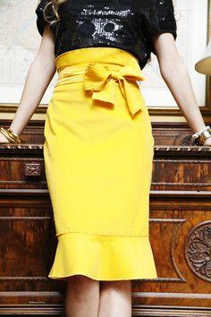 Pencil skirt with paper bag waist and hem ruffle.