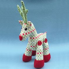 "Rudy is the perfect little friend to grace any shelf or table over Christmas.  He is also a fabulous gift or stocking filler. This pattern is suitable for all skill levels.Completed size:  Approximately 30cm (12"") tall including antlers.Patterns contain full step-by-step instructions and the full sized templates to create your own Rudy reindeer."