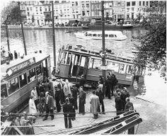 1950. Tram line 4 derailed into the river Amstel in Amsterdam. Photo AHF Collectie IISG /  Ben van Meerendonk. #amsterdam #1950 #Amstel