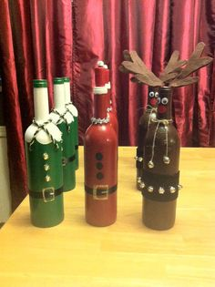 These wine bottles have been hand painted to represent Santa his elf and his reindeer Rudolf! they are so adorable! i am completely in love with these and i know you will be to! these can be shipped or local pick up is always free