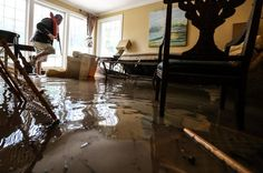 Randy Liggitt surveys flood waters in his Forest Acres home.