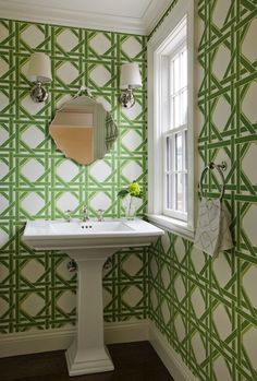 Roof deck powder room covered in white and green garden lattice wallpaper and stained oak hardwood floors.