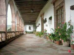 Hacienda style homes courtyard with wrought iron gate in for Case in stile ranch hacienda