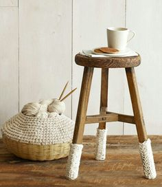 """Knitted """"shoes"""" for a tall stool keeps the atmosphere cozy."""