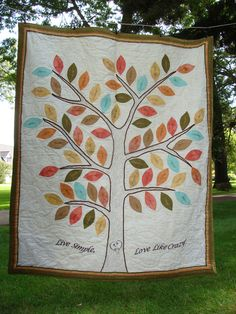 "This quilt was made for my sister-in-law by  our family members and a cousin.   Each leaf has a family members name.  Her and her husbands initials are stitched to appear as if they are carved in the trunk.  The tree itself is stitched to look like bark.  The name of her blog is embroidered below, at the base of the tree.  Multi layered border. We did get the idea from Pinterest, and just made it bigger.  It is approximate 48"" by 52"" in size."