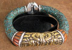 Nepal |  Tibetan style bracelet, silver with inlaid Turquoise and amber