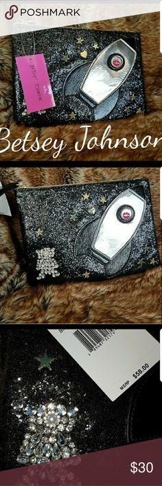 (1 LEFT) BETSEY JOHNSON SPARKLY BLACK WRISTLET! ONLY 1 BAG LEFT!!  BRAND-NEW WITH TAGS!  THIS POUCH IS VERY ECLECTIC! THIS GALAXY BAG IS EXTRATERRESTRIAL WITH A SPACESHIP AND MOON MAN WITH STARS! IT'S OUT OF THIS WORLD!  IT'S VERY SPACIOUS ON THE INSIDE, IT'S  WIDE OPEN! WILL LIST DEMENTIONS LATER TODAY. ANY QUESTIONS? LET ME KNOW. THANKS FOR VISITING MY CLOSET! HAVE A GREAT DAY! Betsey Johnson Bags Clutches & Wristlets