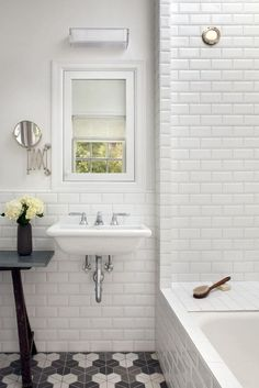 white beveled subway tiles & floor.  Loves the combo of the clean walls with cool tile.