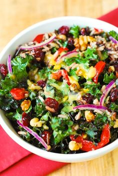 Holiday Kale salad with walnuts, cranberries and wild rice. Gluten free and vegetarian. Perfect for Thanksgiving or Christmas dinner.