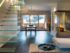 Apartments:Elegant Modern Penthouse Inspiration With Wood Floor And Mid Century Dining Table Ste Also Ultra Modern Stair Added Modern Glass Fireplace Luxurious Modern Penthouse Decor for You