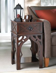 Its a side table with exotic flair! The Moroccan style tables intricate details will certainly add a dash of spice to your room. It features a pull-out drawer and lower shelf framed by beautiful Moroc