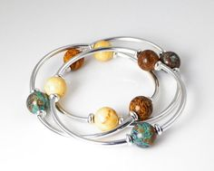 Hey, I found this really awesome Etsy listing at http://www.etsy.com/listing/116793711/bangle-bracelet-blue-yellow-brown-jasper