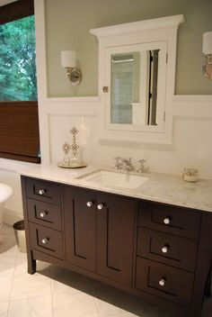 Wall color: BM Gray Wisp. Trim: BM Simply White Tub: 68 sunrise specialty with hardware Vanity: Shiloh furniture style vanities in espresso. Sink: Kohler Memoirs Medicine Cabinets: RH Cartwright Large Sconce: Hudson Valley Countertops: polished carrera marble