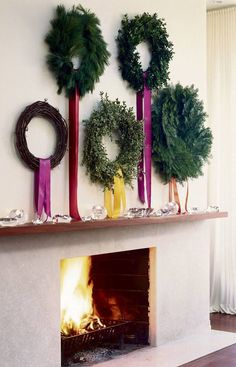 Holtwood Hipster: Evergreen - modern Christmas wreaths hung in a cluster on the wall for beautiful Christmas decor with minimal effort Christmas Fireplace, Christmas Mantels, Noel Christmas, Merry Little Christmas, Modern Christmas, All Things Christmas, Winter Christmas, Christmas Wreaths, Christmas Decorations