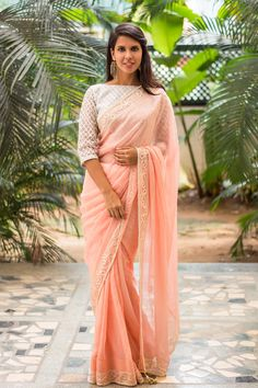 Who doesn't look at a girl in pink? Such a softly feminine drape in a soft peachish pink georgette with a truly delicate looking border in white lace threadwork with pearls…A sigh worthy saree this!A silver blouse to shimmer like an ethereal being. A white or floral blouse to yet be oh so feminine. A peach pink blouse for a one tone look. Lastly a black blouse for some statement making. #peach #pink #georgette #lace #saree #India #blouse #houseofblouse