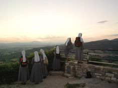 Insta / natgeotravel: Photo by @justinbriceguariglia // Nuns from Germany overlooking the town from the ramparts of Rocca Maggiore the larger of two castles in Assisi Italy. #natgeotravel #Assisi #Italy #justinbriceguariglia #nuns #fromwhereistand