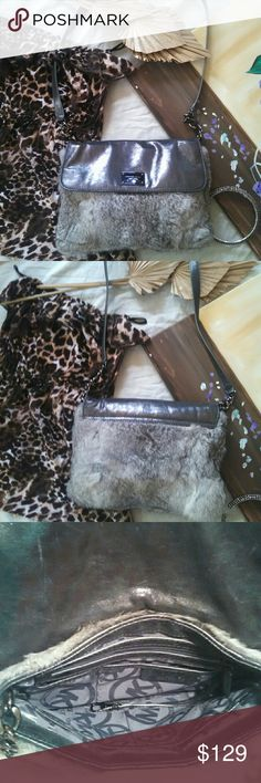 Authentic MK Fur & Leather shoulder bag/crossbody NWOT Michael Kors Authentic Fur & Leather Bag. Perfect as a shoulder bag or cross body. Soft leather and rabbit fur for a classic MK design. Metaluc grey hardware.  Thank you for shopping my closet. Michael Kors Bags Shoulder Bags